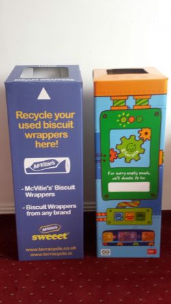 Collection boxes for McVities biscuit wrappers and Ella's Kitchen food pouches in the Zero Waste Cashel office